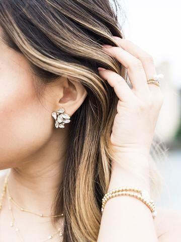 These brilliant clusters are the perfect way to give your lobes a dose of sparkle. With a celestial mix of crystals, these stud earrings are an everyday essential for the sophisticated glam girl. - 14