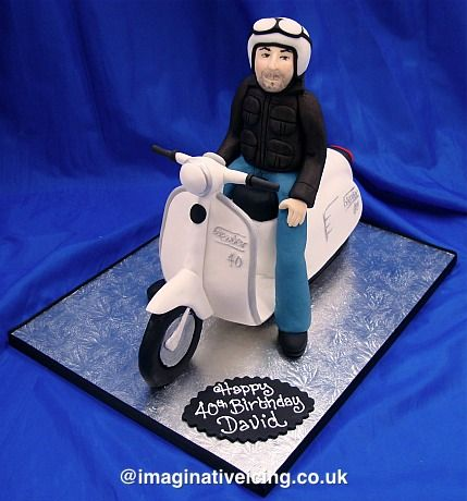 Man riding a white Scooter/Lambretta/Vespa shaped Birthday Cake