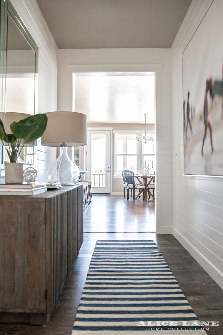 Lakeside Loft entry hallway with shiplapped walls! Designed by Alice Lane