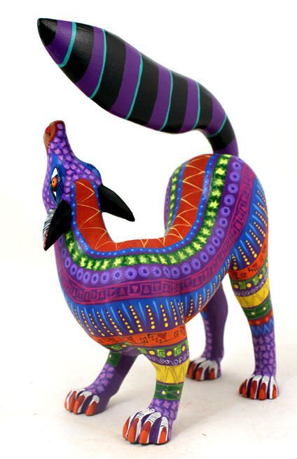 "A beautiful fox with a fantastically colored coat in Oaxacan Alejibres - ""fantastical animal"" - style.   Legend has it that, while very ill, Alejibres creator Pedro Linares Lopez had a feverish dream where he saw many mythical creatures.  When he recovered he began making papier mache piñatas featuring them. Oaxacan Alebrijes were pioneered by Manuel Jimenez, who made intricately carved and painted pieces."