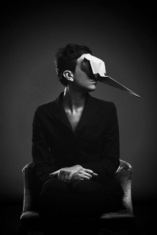 """One of Us par Giacomo Favilla et Francesca Lombardi - Journal du Design / """"Intitulé One of Us, le projet se compose de magnifiques portraits en noir et blanc, de gens portant des masques d'animaux en origami, assis dans un fauteuil. L'intention était de créer une impression de monde imaginaire, où nature animale et humaine se mélangent en une seule entité. Chaque masque a été subtilement plié maintes et maintes fois pour ressembler à un animal différent."""""""