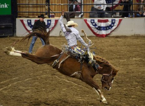 Professional cowboy Wyatt Casper hangs on during the saddle bronc competition