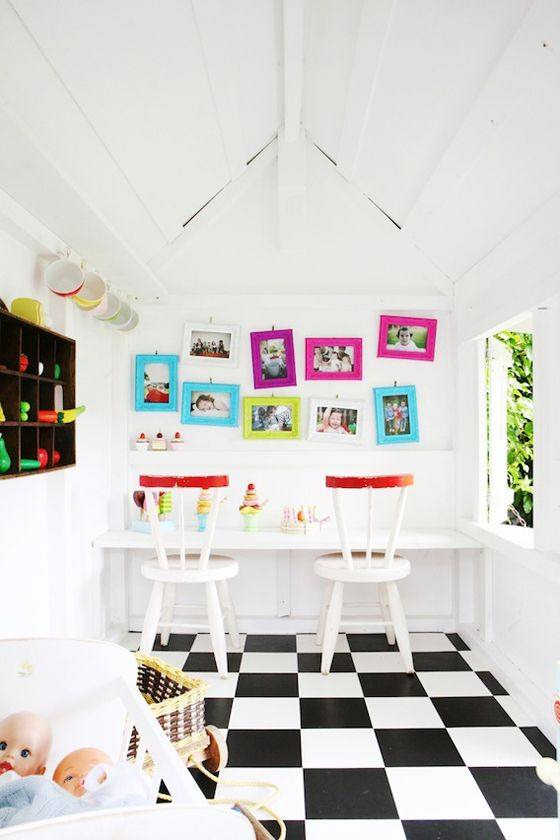 Play house: black and white floors, counter with stools.