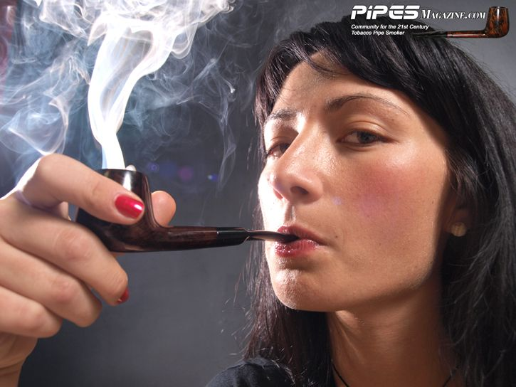 Raven-Haired Beauty Elena Relaxes with Her Pipe
