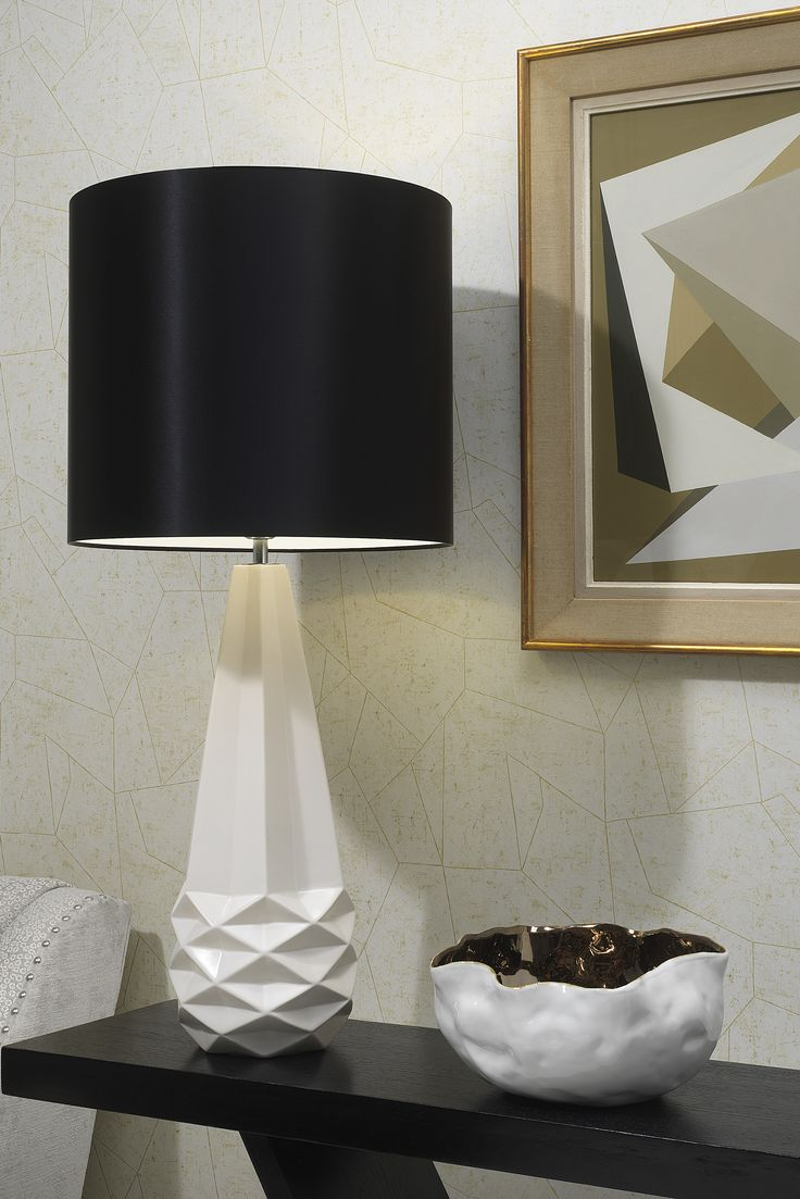 The Salerno table lamp draws inspiration from iconic 1950's geometric sculptures, resulting in an intricate, yet elegant arrangement of bold, clean lines that creates a striking, symmetrical form.