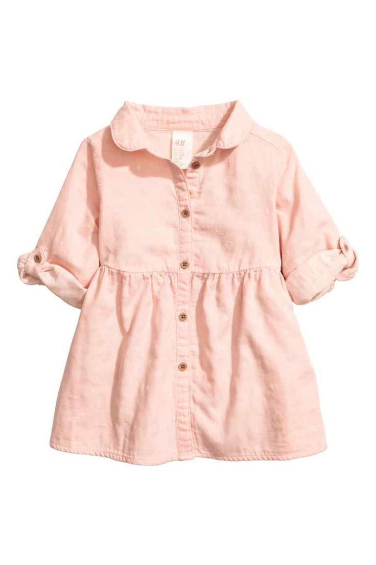 Shirt dress: Shirt dress in a soft, patterned cotton weave with a Peter Pan collar, buttons down the front, long sleeves with a tab and button and a gathered seam at the waist.