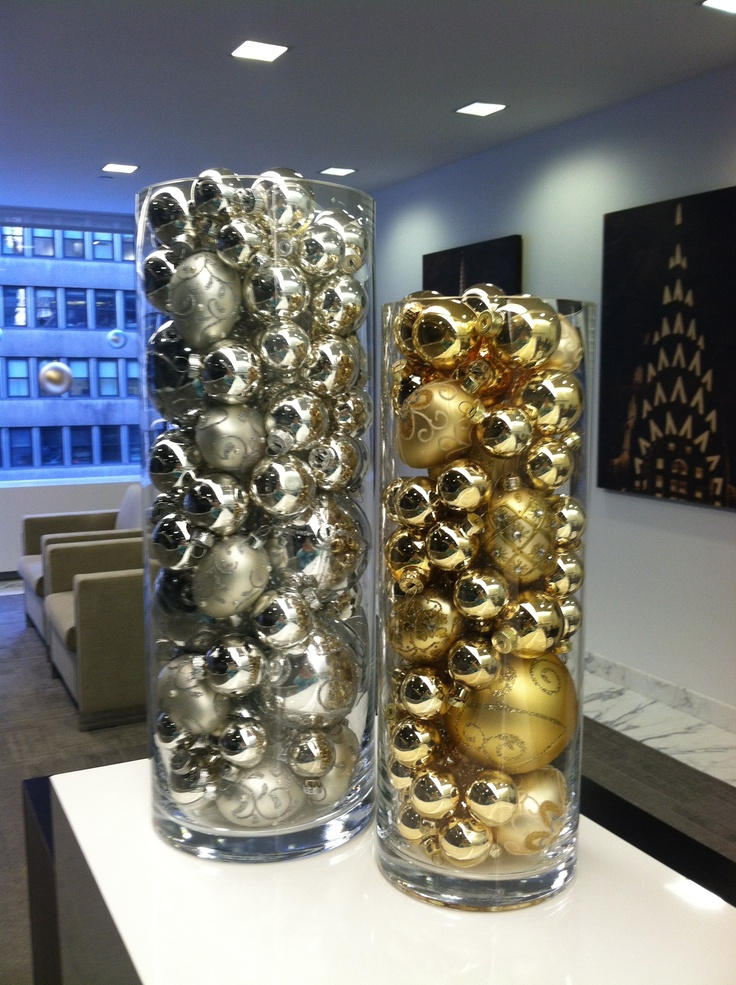 Gold silver christmas balls in glass vases
