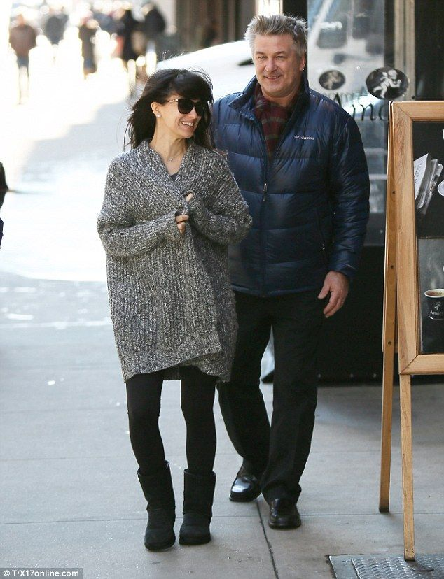 Bundled up for two! Alec's pregnant wife Hilaria Baldwin wrapped up in a thick grey coat w...
