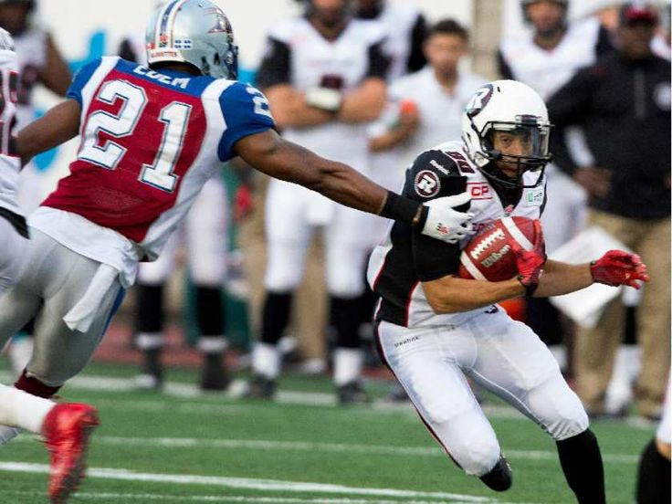 Montreal Alouettes safety Mike Edem gets a hand on Ottawa Redblacks wide receiver Chris Williams during CFL action at the Percival Molson Stadium in Montreal on Thursday June 25, 2015.