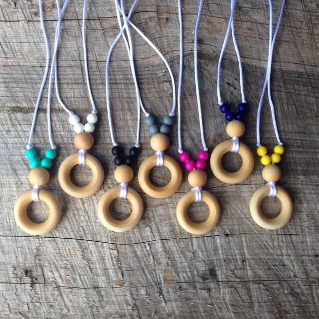 Natural Wood Bead and Silicone Teething Necklace for Mom/ Nursing Necklace / Babywearing Necklace   Chewelry by NomNomNecklaces on Etsy https://www.etsy.com/listing/201924401/natural-wood-bead-and-silicone-teething