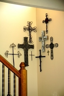 Recently moved my cross collection to a corner  at the base of our staircase.  Love the ease of adding to this collection because I can spread it to both walls.  It makes an impact now and will just get better.