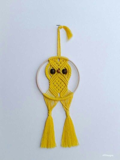 "Golden/lemon yellow owl on a 6"" beech hoop. Available to buy through my Facebook page. www.facebook.com/AnnePearsonDesigns #macramé #knotwork #handmade #owl #yellow"
