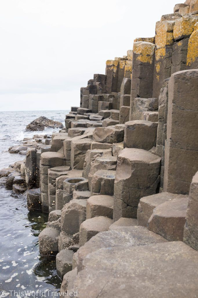 The crashing wave against the stacked basalt columns of Giant's Causeway in Northern Ireland