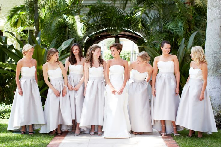 Our Alfred Sung hi-lo two-toned dress is shining on these girls!  They personalized their look by choosing their favorite hairstyles, shoes and jewelry. #DessyRealWeddings