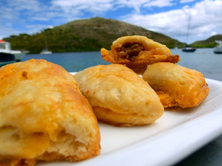 An empanada or empanadilla (called pastel in Brazilian Portuguese) is a stuffed bread or pastry baked or fried in many countries in South Europe, Latin America, and parts of Southeast Asia. The name comes from the Galician, Portuguese and Spanish verb empanar, meaning to wrap or coat in bread. #VirginGorda #FatVirginCafe #BVI's #BritishVirginIslands #Caribbean #Food