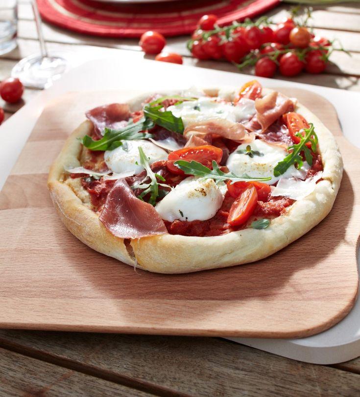 Pizza mit Rucola und Parmaschinken Rezept