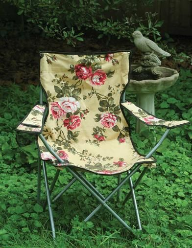 Glamour & Camping. Sumptuous chintz roses are spattered across a field of buttery yellow cotton canvas. This romantic lawn chair folds into carrying case.