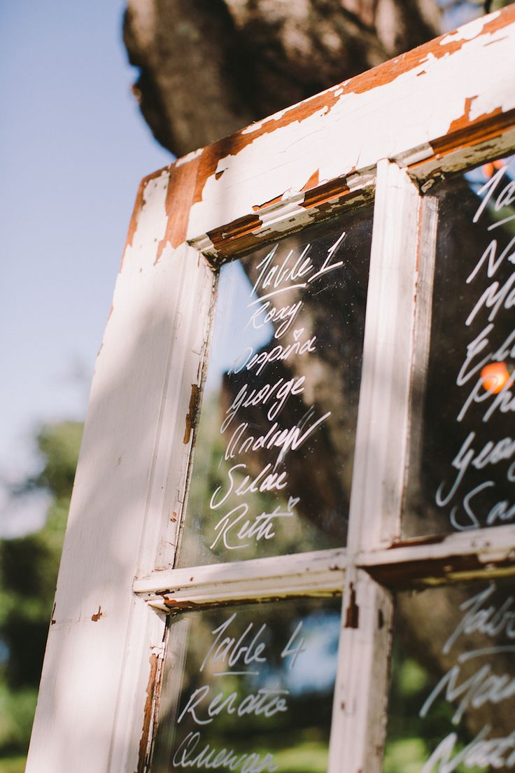 Roxy Burger's fairytale wedding at Forest Hall in Plettenberg Bay. Click for more. Table seating on an old wooden door.