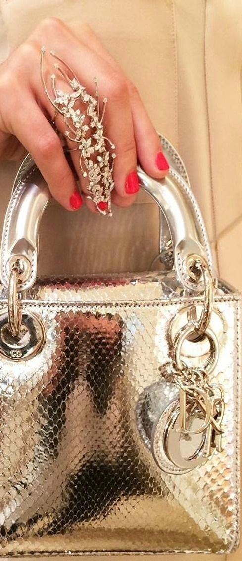 Dior!...but its not the bag...Its all about the ring. :)