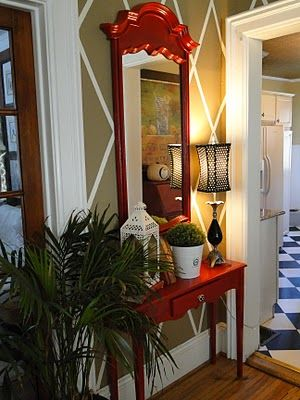 Love the red mirror...diy molding & paint