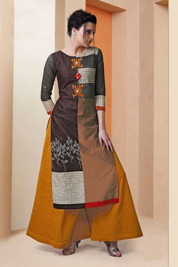 Make a stunning appeal wearing this exuberant designer kurti in silk bearing patches of fabric done in shades of brown & grey with self textures and lovely appliqué patches decorate the centre bodice along with decorative buttons in a glorious feel!