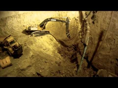 Video of RC construction equipment excavating a guy's basement. He spent 5 years excavating his basement.