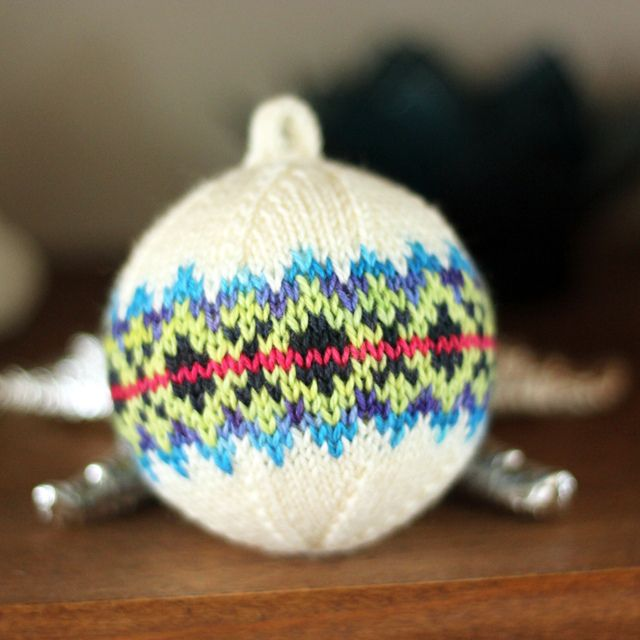 Knitted Christmas ball with a styrofoam ball in the center. Made by Tanis from a pattern by General Hogbuffer