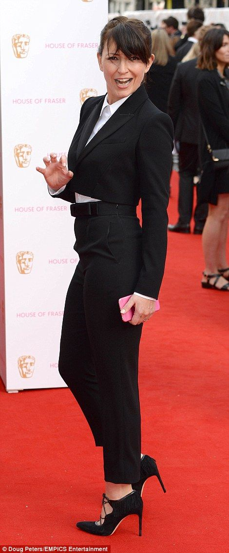 Suit up: Davina McCall swapped the glam gown in favour of a jacket and trouser combo finis...