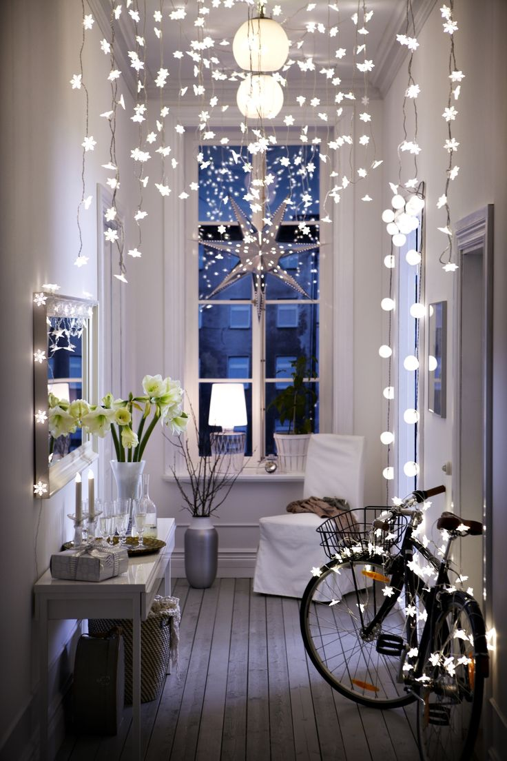 Christmas in the air!  Lovely snowflake lights. Very enchanting! #lights #christmas #snowflakes #design