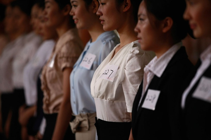 Women attend an interview during a job fair for China Eastern Airlines flight attendants in Shanghai, on October 19, 2012. Some 2,000 people signed up for interviews as China Eastern Airlines planned to recruit 800 flight attendants from Shanghai, local media reported. (Reuters/Aly Song) #