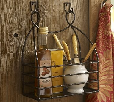 """Cucina Condiment Rack  $34.00 sale $19.99  Catalog/Internet Only  Store often-used tall bottles and kitchen supplies in our iron condiment rack. The attractive curlicue top mounts easily to the wall.  10.5"""" wide x 4.5"""" deep x 12"""" high  Sold individually.  Made of iron with a bronze finish."""