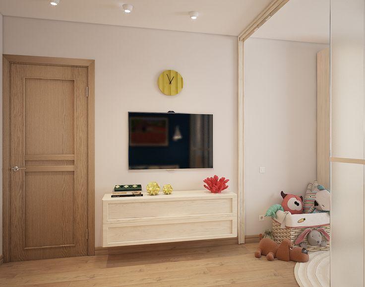 Вид на ТВ-уголок в комнате, совмещающей функции гостиной и детской, в квартире на севере Москвы.