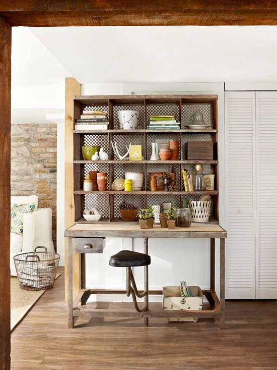 Top a vintage worktable with a metal shelving unit to create the ultimate work space. The pairing works well as a potting bench or paperwork desk! http://www.bhg.com/decorating/storage/projects/from-flea-market-finds-to-savvy-storage/?socsrc=bhgpin042415metalshelvingstorage&page=24