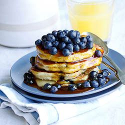 A great way to start the day! Delicious, light and fluffy blueberry-ricotta pancakes, drenched in syrup.