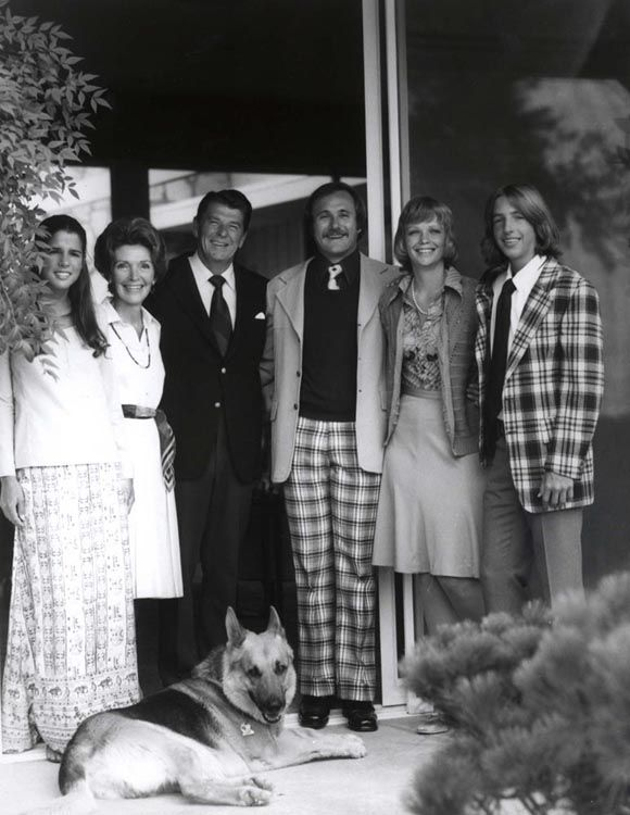 "The Reagan family at their house in Pacific Palisades, California. From left to right: Patti Davis, Nancy Reagan, Ronald Reagan, Michael Reagan, Maureen Reagan, Ron Reagan and dog ""Pogo."" 1976. 40th #President of the United States 42nd #FirstLady."