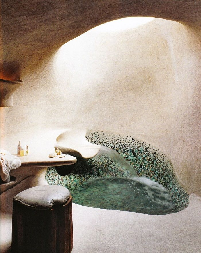 Cob room with bathtub and pebble mosaic. Nice organic shapes.