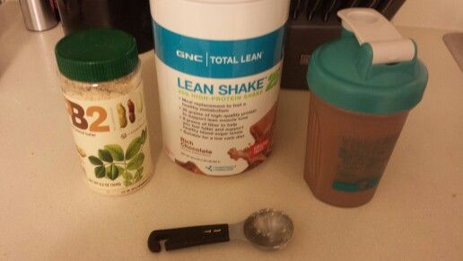 Peanut Butter Cup Protein Shake 1 tbsp of PB2, 1.5 scoops of GNC Lean Shake 25- Rich Chocolate,  and 8 oz of water in blender bottle. Mix it up- and I add more water to make 14 oz. Tastes like a Reeses Peanut Butter Cup for 173 calories!!!