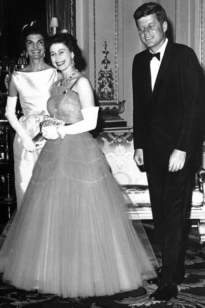 Britain's Queen Elizabeth walks with U.S. President John F. Kennedy and his wife, Jacqueline Kennedy, as they enter an ante-room in Buckingham Palace on June5,1961, before a dinner given by the queen in honor of the Kennedys.