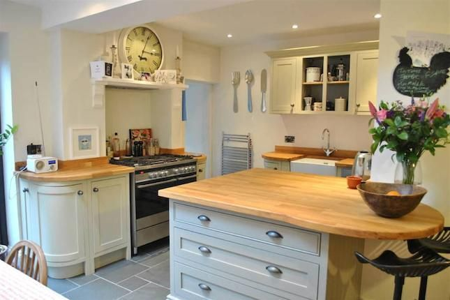 Bijou kitchen packed with interesting features - curves, range, chimney breast, bar, dining area.