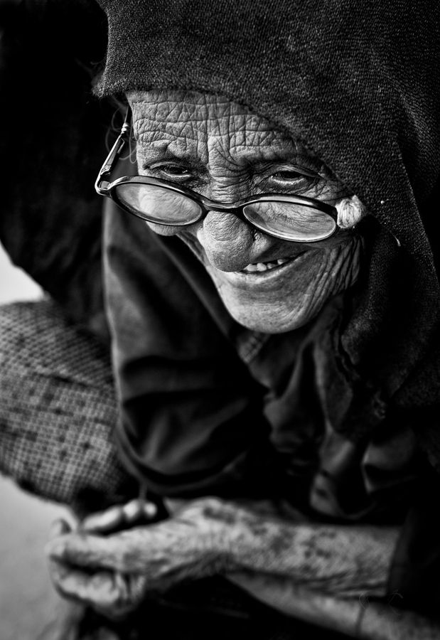 "Wrinkled Past fot Harshit Thaker ""An Old Rabari Women, here telling the stories of her life, she told us the Story of a 'Bhua', Bhua's are Rabari Village's Saint, they consider them as Messengers of god, All Rabari's Follow a 'Bhua', They Believe in every word of 'Bhua', so much so that, if a 'Bhua' proclaims its 'Night' in Middle of Hot day, they will Believe it !"""