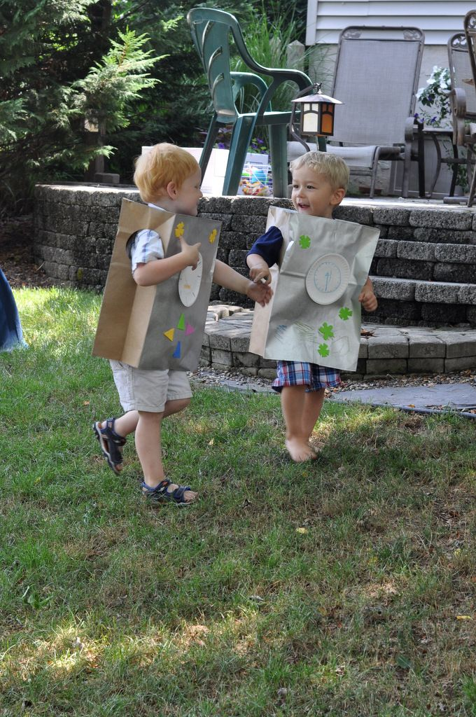 spray paint paper bags silver and cut holes beforehand. let kids decorate them at the party.