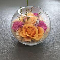 Fish bowl vase flower arrangement created by Madison in Bloom Floral Design. www.facebook.com/madisoninbloom www.instagram.com/madisoninbloom www.madisoninbloo...