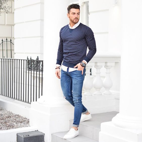 For a comfortable-as-your-couch outfit, dress in a navy blue polka dot crew-neck jumper and blue distressed slim jeans. White low top sneakers will instantly smarten up even the laziest of looks.
