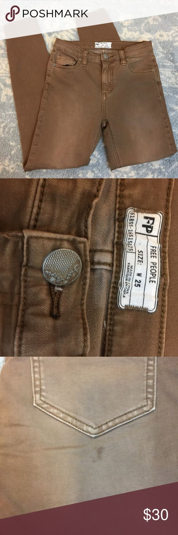 Free People Brown Skinny Jeans Free People Brown jeans with a skinny bottom hem and have a stain on the back pocket that might be removable...super cute and size 25 Free People Jeans Skinny