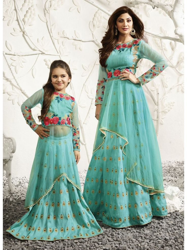 Aqua Blue Dual Tone With Multicoloured Embroidered Lehenga Choli Set has delicate embroidery on neck and waist over raw silk fabric with layer of net kalidar top inside paired with matching pure raw silk lehenga bottom and chiffon dupatta with stone. Style this beautiful dress with traditional jewellery and heels to look ravishingly beautiful this wedding or festive season. The set is also available as combo of mother and daughter set so let your twinning game be strong with the best bond.