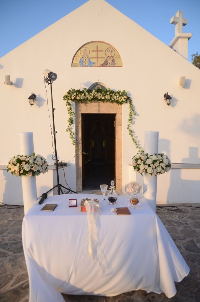 Church decoration #greekweddings #churchdecor #flowers #weddingscrete #yuccaflowers