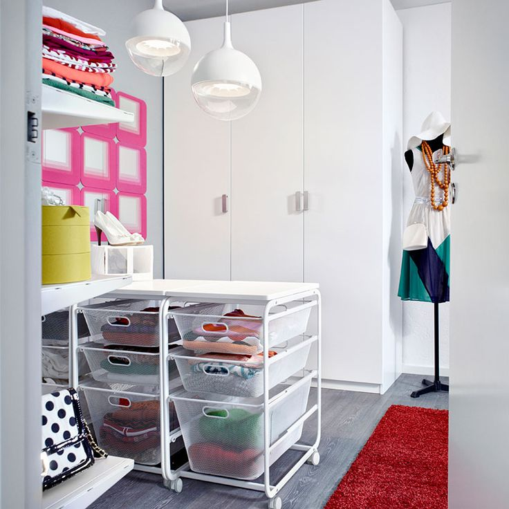 PAX white wardrobe with TANEM white doors and ALGOT frames with top shelf, baskets and castors all in white
