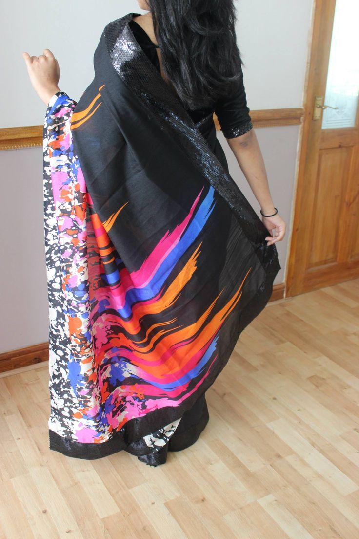 A black raw silk printed saree/sari with 3inch black sequins on the edge.Also included is a hot pink nylon net for the pleats with black sequins ( 3inch width ) on the edge.  Blouse: Pink semi raw silk  ( Net colour,unstitched)   If you would like to place an order for this Saree, Please email us at prishaboutique@hotmail.com or simply message us.  Alternatively visit our Facebook page  www.facebook.com/prishaps #sari#saree#bollywood#indian#attire#wear#traditional#black#pink#designer#uk