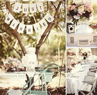 Check out the vintage camera/suitcase combination with the pale-hued flowers.