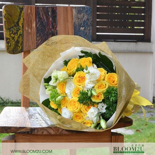 Donna Sheridan is a lovely bouquet consists of 20 stalks yellow roses and eustoma flowers. This bouquet is very elegant and the cheerful yellow color will make her day.